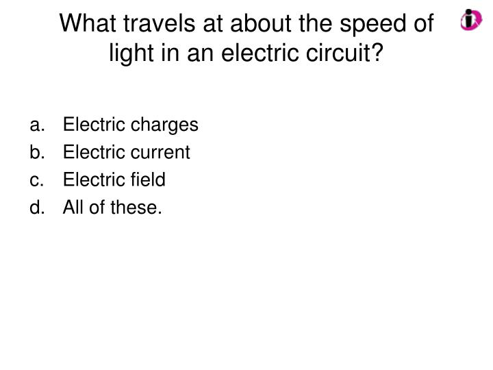 What travels at about the speed of light in an electric circuit?