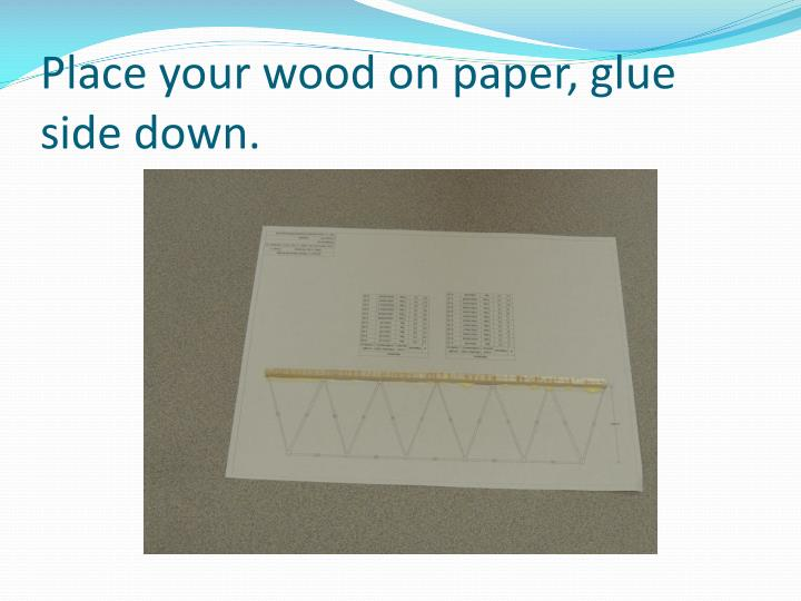 Place your wood on paper, glue side down.