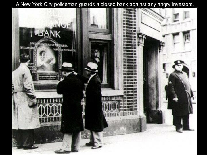 A New York City policeman guards a closed bank against any angry investors.
