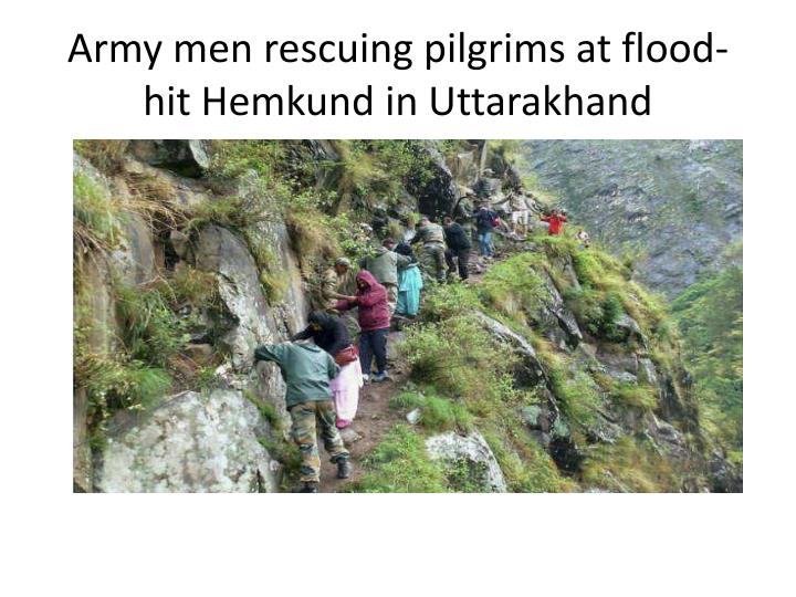 Army men rescuing pilgrims at flood-hit