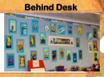 behind desk
