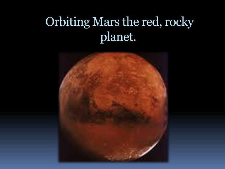 Orbiting Mars the red, rocky planet.