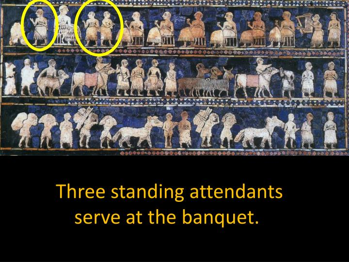 Three standing attendants