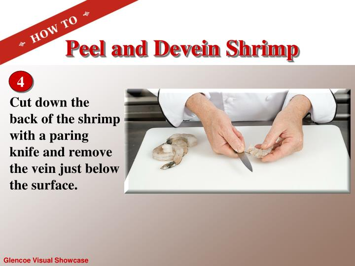 Cut down the back of the shrimp with a paring  knife and remove the vein just below the surface.