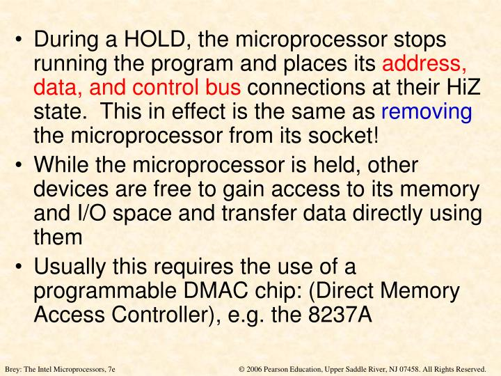 During a HOLD, the microprocessor stops running the program and places its