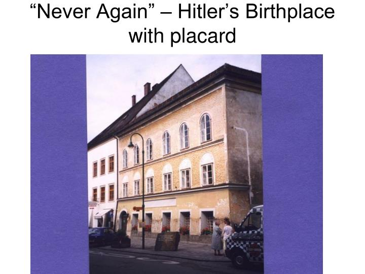 """Never Again"" – Hitler's Birthplace with placard"