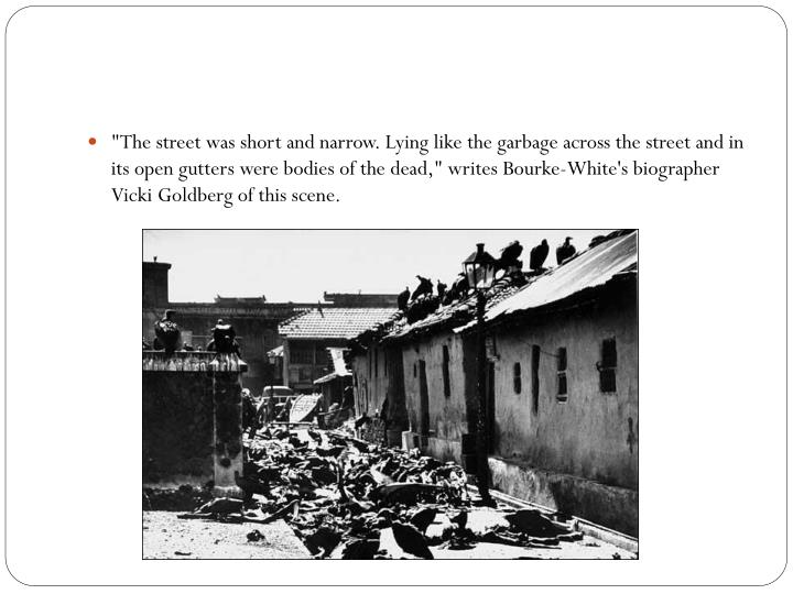 """The street was short and narrow. Lying like the garbage across the street and in its open gutters were bodies of the dead,"" writes Bourke-White's biographer Vicki Goldberg of this scene."