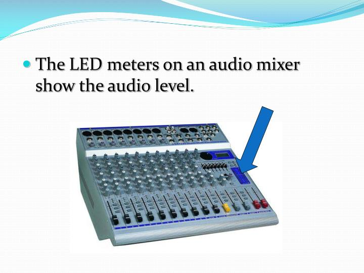 The LED meters on an audio mixer show the audio level.