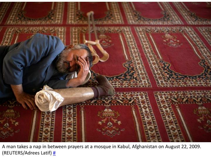A man takes a nap in between prayers at a mosque in Kabul, Afghanistan on August 22, 2009. (REUTERS/