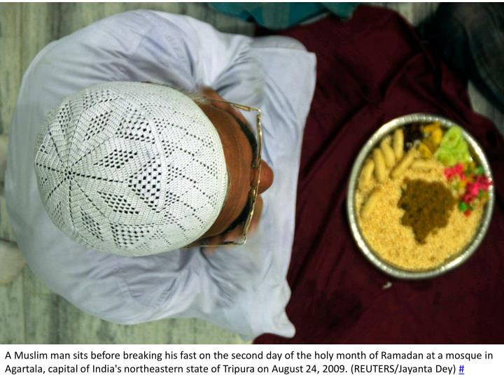 A Muslim man sits before breaking his fast on the second day of the holy month of Ramadan at a mosque in