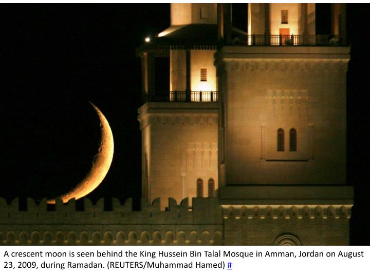 A crescent moon is seen behind the King Hussein Bin