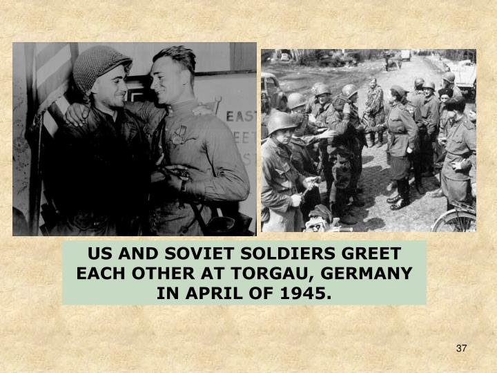 US AND SOVIET SOLDIERS GREET EACH OTHER AT TORGAU, GERMANY IN APRIL OF 1945.