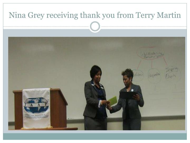Nina Grey receiving thank you from Terry Martin