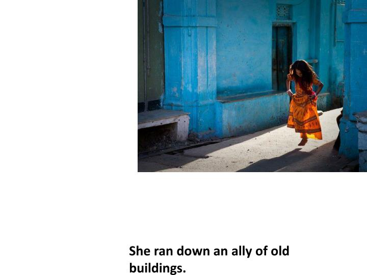 She ran down an ally of old  buildings.