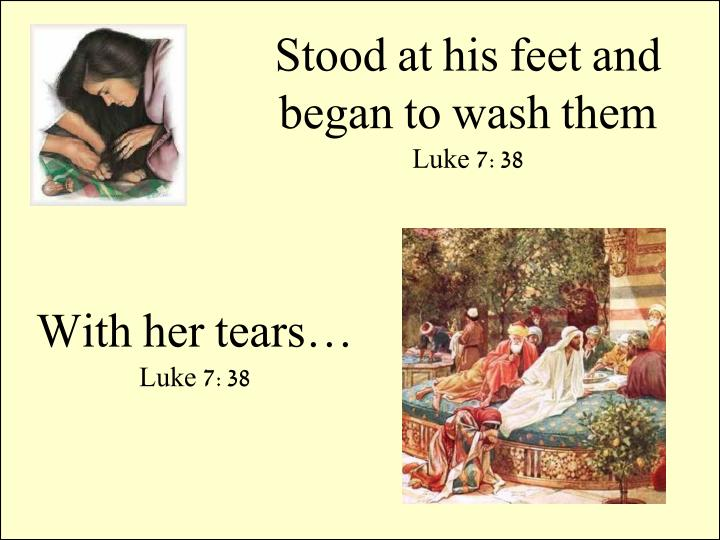 Stood at his feet and began to wash them