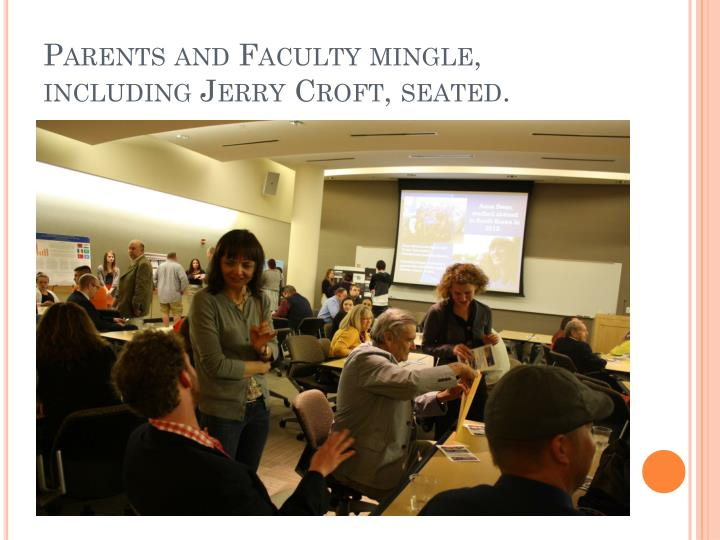Parents and Faculty mingle, including Jerry Croft, seated.