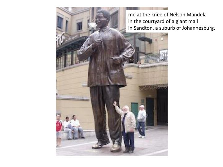 me at the knee of Nelson Mandela