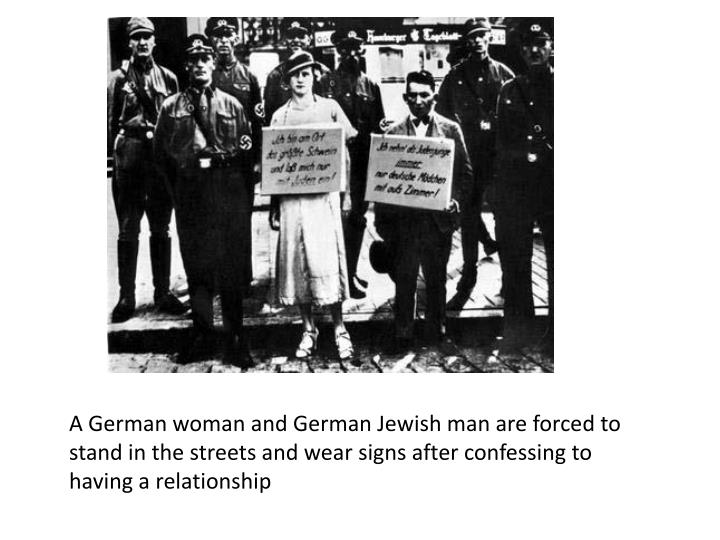 A German woman and German Jewish man are forced to stand in the streets and wear signs after confessing to having a relationship