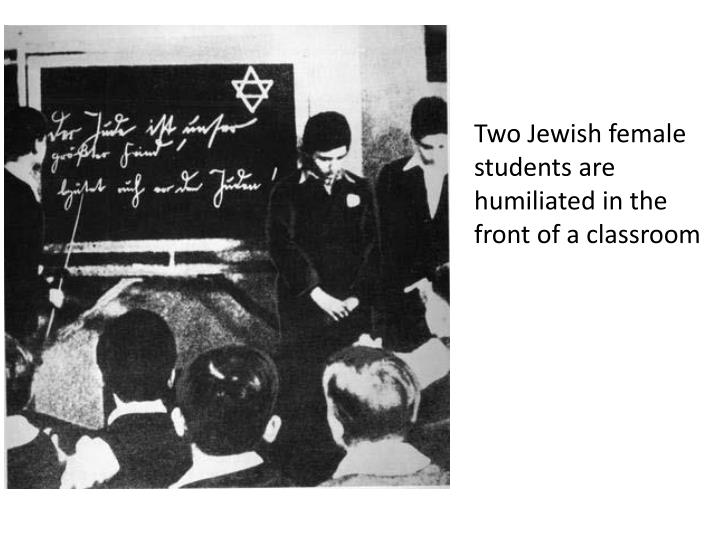 Two Jewish female students are humiliated in the front of a classroom