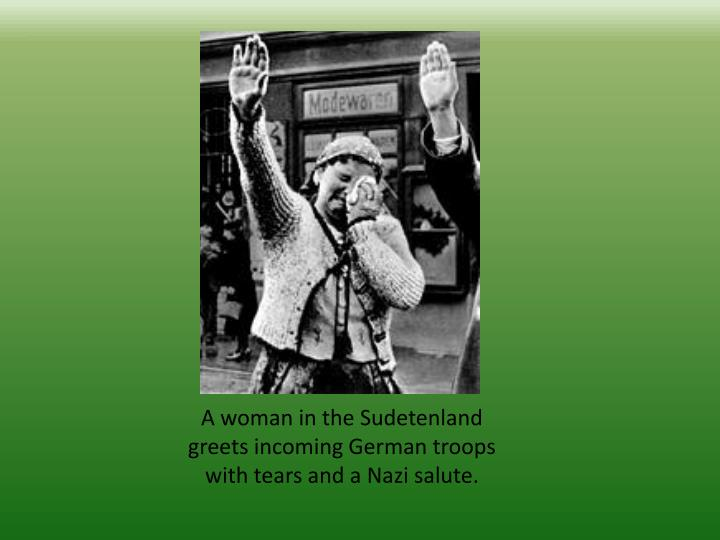 A woman in the Sudetenland greets incoming German troops with tears and a Nazi salute.