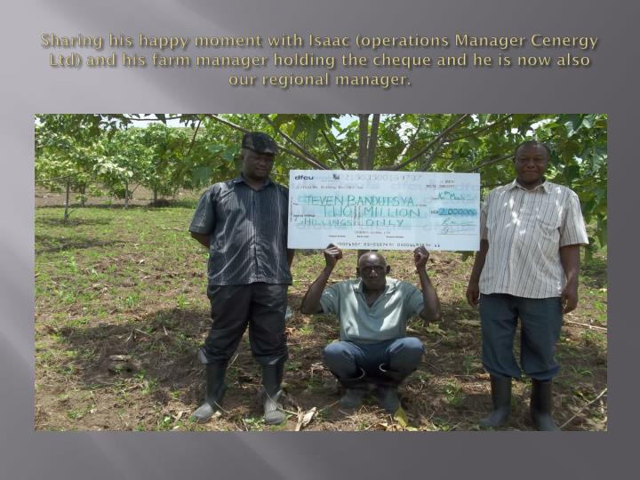 Sharing his happy moment with Isaac (operations Manager Cenergy Ltd) and his farm manager holding the cheque and he is now also our