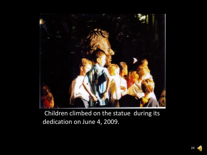 Children climbed on the statue  during its dedication on June 4, 2009.