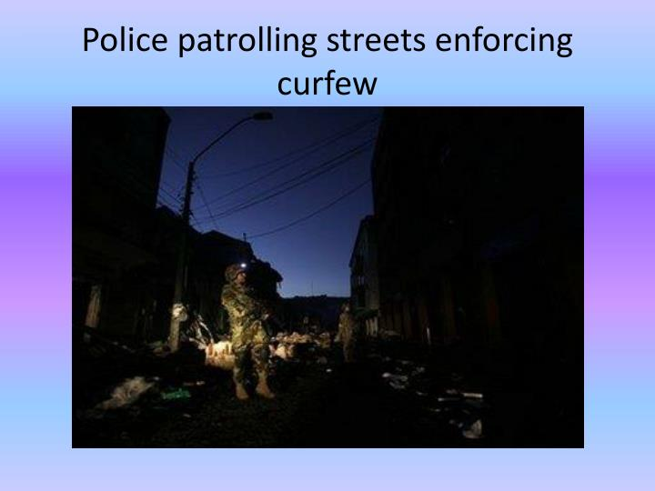 Police patrolling streets enforcing curfew