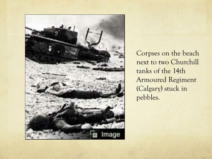 Corpses on the beach next to two Churchill tanks of the 14th