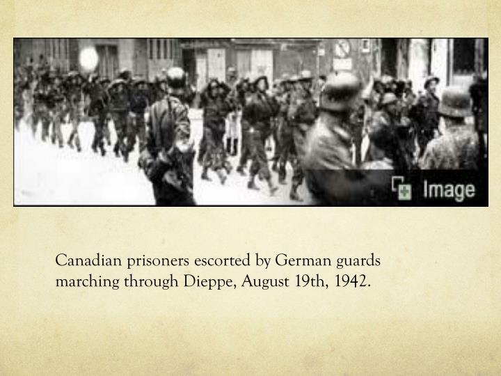 Canadian prisoners escorted by German guards marching through Dieppe, August 19th, 1942.