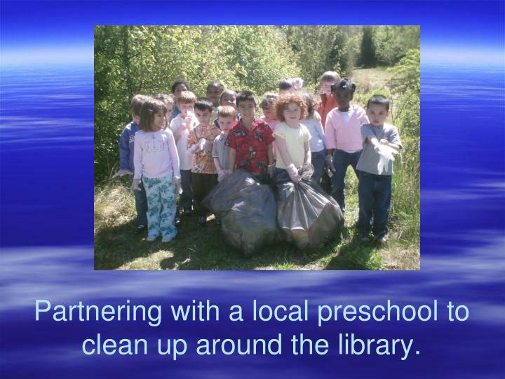 Partnering with a local preschool to clean up around the library.