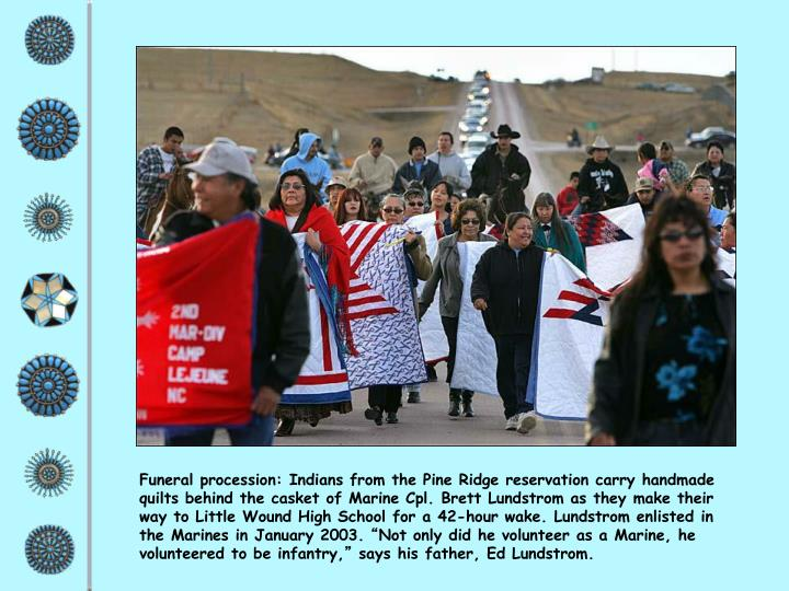 Funeral procession: Indians from the Pine Ridge reservation carry handmade quilts behind the casket of Marine Cpl. Brett Lundstrom as they make their way to Little Wound High School for a 42-hour wake. Lundstrom enlisted in the Marines in January 2003.