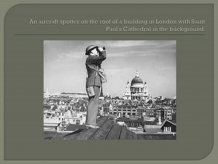 An aircraft spotter on the roof of a building in London with Saint Paul's Cathedral in the background.
