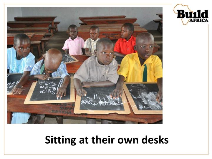 Sitting at their own desks
