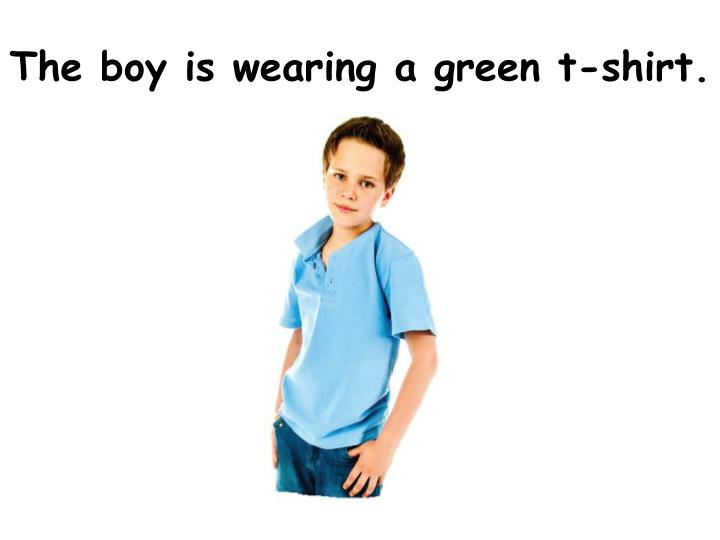 The boy is wearing a green t-shirt.