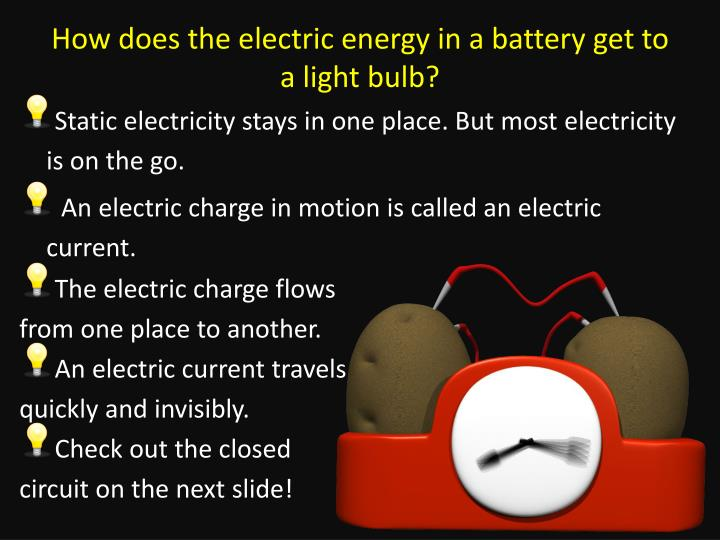 How does the electric energy in a battery get to a light bulb?
