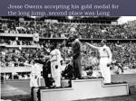 jesse owens accepting his gold medal for the long jump second place was long