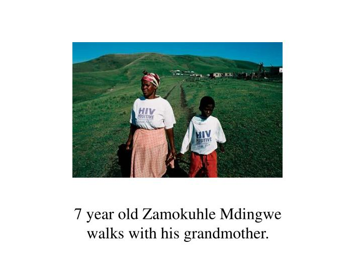 7 year old Zamokuhle Mdingwe walks with his grandmother.