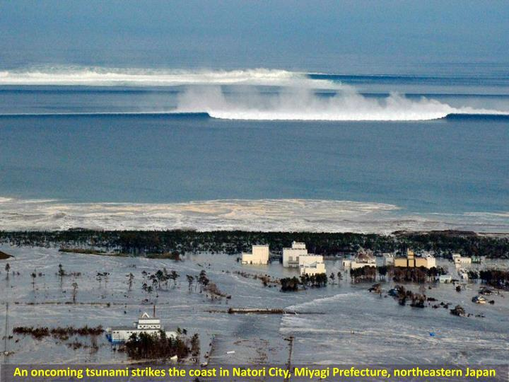 An oncoming tsunami strikes the coast in