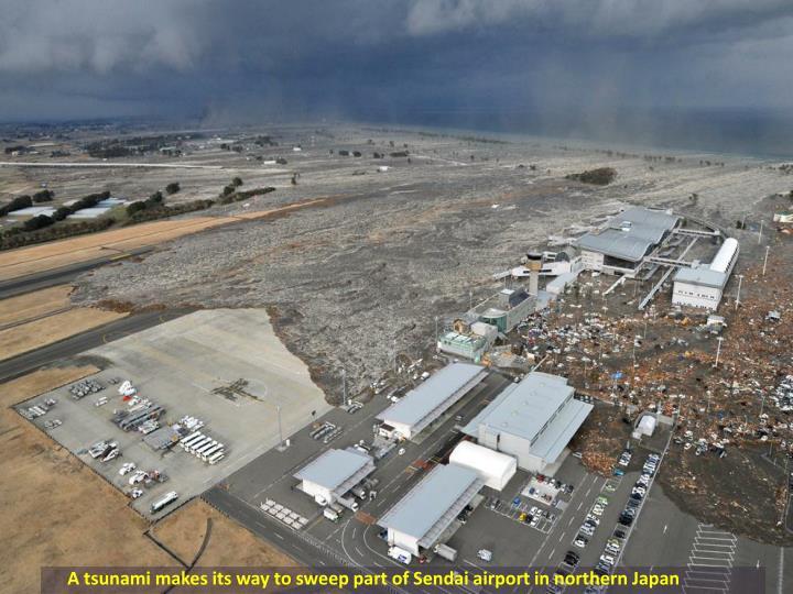 A tsunami makes its way to sweep part of Sendai airport in northern Japan