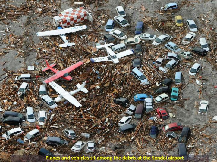 Planes and vehicles sit among the debris at the Sendai airport