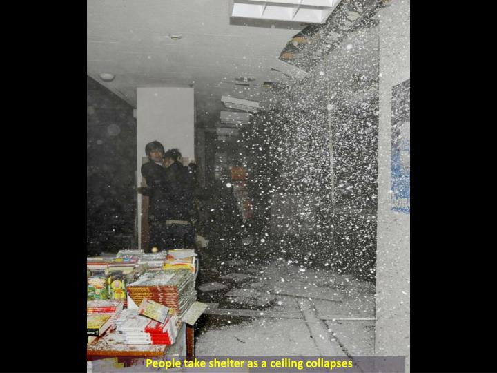 People take shelter as a ceiling collapses