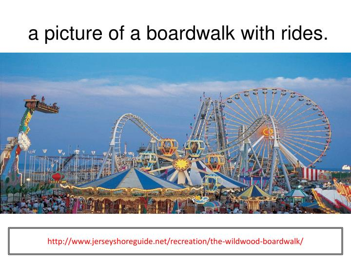 a picture of a boardwalk with rides.