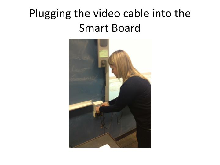 Plugging the video cable into the Smart Board
