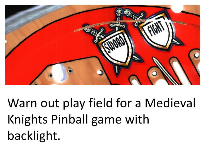Warn out play field for a medieval knights pinball game with backlight
