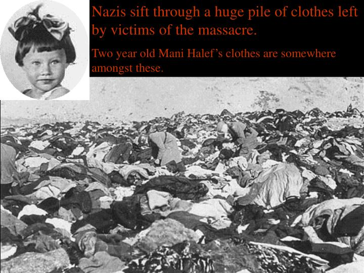 Nazis sift through a huge pile of clothes left by victims of the massacre.