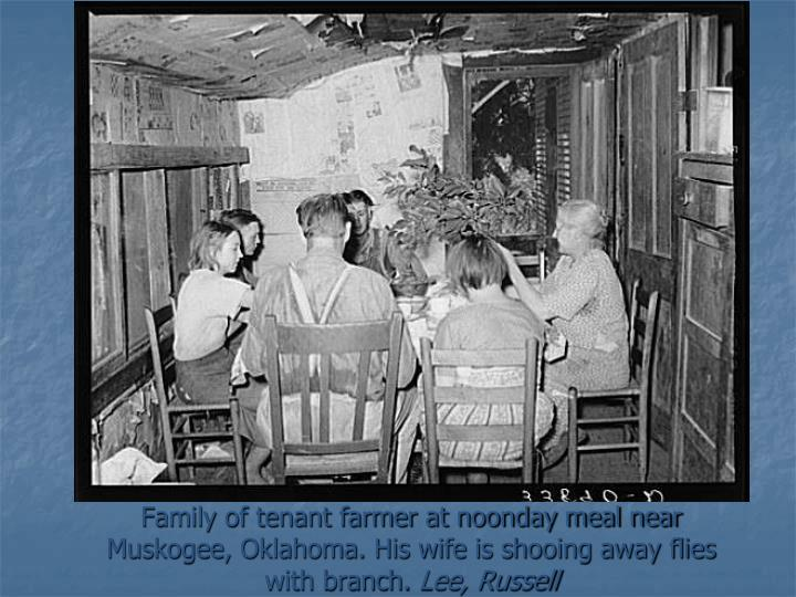 Family of tenant farmer at noonday meal near Muskogee, Oklahoma. His wife is shooing away flies with branch.