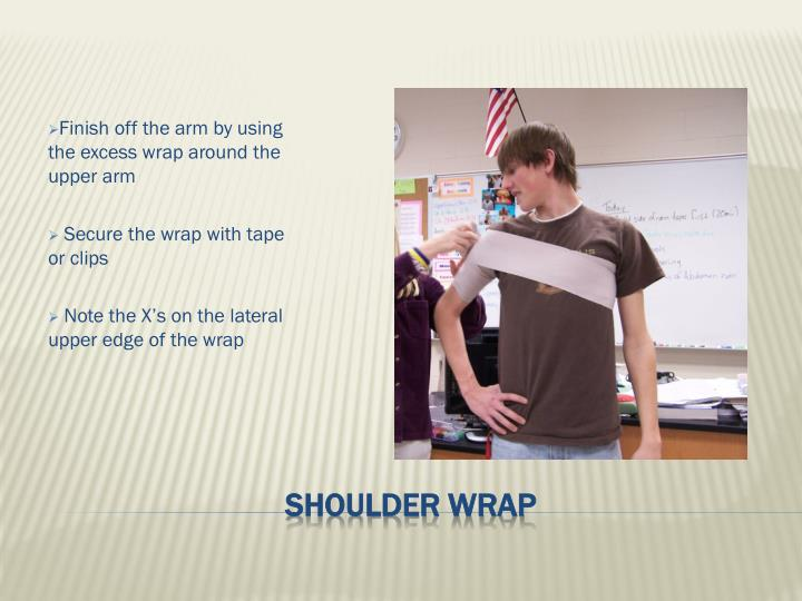 Finish off the arm by using the excess wrap around the upper arm
