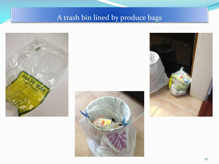 A trash bin lined by produce bags