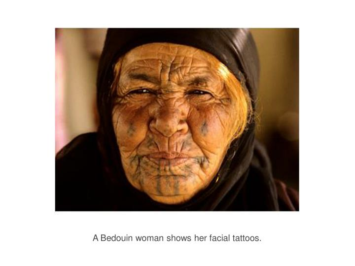 A Bedouin woman shows her facial tattoos.