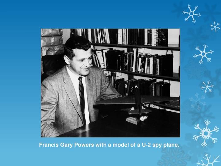 Francis Gary Powers with a model of a U-2 spy plane.
